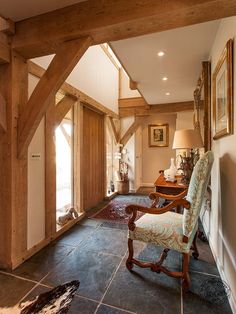 Hallway with Exposed Oak Frame in New Build House in Cornwall by Carpenter Oak Ltd