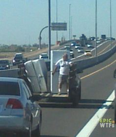 Yes, standing in front of the fridge will prevent it from falling off the trailer. Doesn't everyone travel like this??