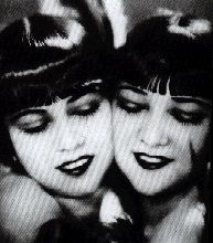 1920s Makeup- Smokey 1920s Eyes and Arched Eyebrows, thick eyelashes, cupids bow red lipstick. http://www.vintagedancer.com/1920s/makeup-starts-the-cosmetics-industry/