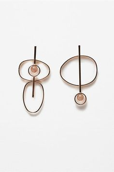 This New Minimalist Jewelry Trend Isn't What You'd Expect #refinery29  http://www.refinery29.com/minimal-dangly-earrings#slide-1  Mix-and-match with a set of earrings that are slightly different.Zara Circular Earrings, $15.90, available at Zara....