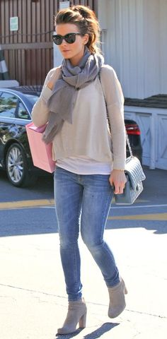 Kate Beckinsale is sporty chic topped off with a pair of high heeled booties. Get the look here.