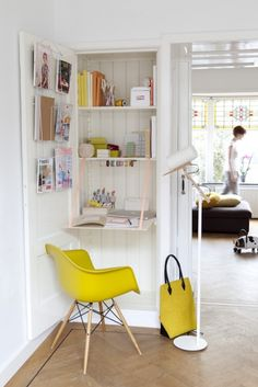A small home office in a cupboard. Shut the door when you don't use it. Place the accent chair in the living room or dining room.