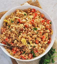 Enjoy this delicious and light recipe for artichoke quinoa salad, its great as a side dish or as a main! Add some chopped tomatoes, onion, artichoke hearts, garlic, parsley with olive oil and lemon.
