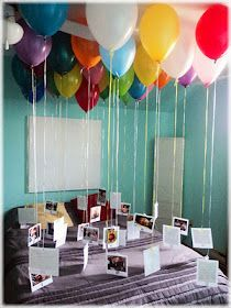 Birthday surprise with balloons. For boyfriend's 30th birthday. 30 colorful balloons filled with helium. The great surprise idea is the photos hanging on the string. A photo for each year of person's life!   It's a fab idea for any romantic (or less romanitc;) occasion! I was thinking, in case I can't find helium, to try and see if I can attach the ballons to the ceiling with tape...