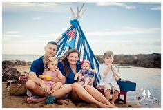 family at the beach teepee