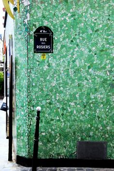 Lovely green tiles, Paris.  Perhaps a patter like this, not an actual design/ basemnet wall outside