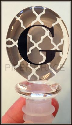 """Acrylic oval winestopper with quatrefoil pattern and initial. 1 5/8""""x 1 1/4"""" x 3 1/3"""" Additional patterns and personalization available. $8 + shipping"""
