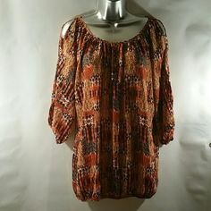 Nice Orange top. Evening or casual or all around function. This is the perfect blouse for that time. Polyester 100% Elastic cuff and waist. NWOT Never worn Diamante  Tops Blouses