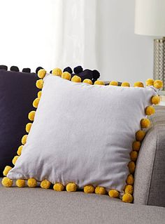 """The Jay St. Block Print Company at Simons Maison.  Designed in Brooklyn and handmade in India, this collection combines artisanal workmanship with an assuredly modern vision.  Plush pompoms frame this soft, brushed velvet square cushion for a fun and decorative combination of textures.    Match with duvet covers from the same collection   100% cotton woven solid underside   Washable with removable cover and a hidden zip on the edging   18""""x18"""""""