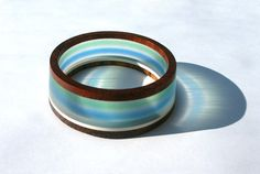 Wood and lucite bangle by karuko