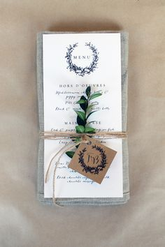 Menu design will look like this- echoing the invitations. It will have a sprig of lavender, olive branch or rosemary on the front with a card from the happy couple attached and the neutral grey linen napkin strapped to the back with twine.