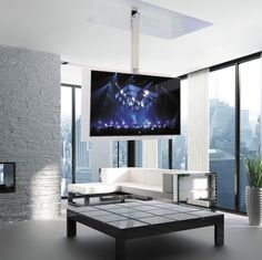 Contemporary TV ceiling mount / remote-controlled / motorized ceiling FLIP 900 R Maior® Tv Hanging From Ceiling, Tv Ceiling Mount, Hanging Tv, Ceiling Tv, Living Room Tv Unit, Living Room Decor, Support Tv Plafond, Tv Escondida, Tv Stand Room Divider