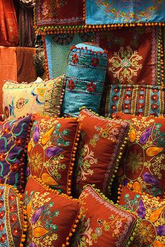 Beads and embroidered pillows.