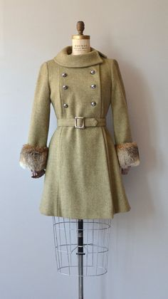 Vintage 1960s light olive green wool winter coat with fox fur cuffs, interior elastic cuff to trap warmth, large rolled collar, double breasted silver