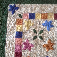 Close-up of flower appliqué quilt top.