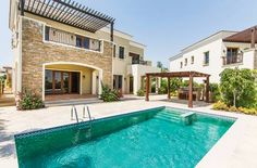 This Jumeirah Golf Estates pad (Dh11 million) has a fab pool & covered barbecue LUXHABITAT