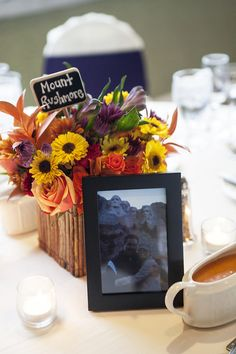 Make your table settings personal by showcasing photos from throughout your relationship! Love the addition of the location to the centerpiece. {@izzyhudgins}