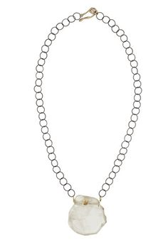 """Julie Cohn Design: This crystal quartz slab pendant looks as though it has been chipped off a glacier. It hangs from an oxidized chain with a bronze closure. 23"""" inches long."""