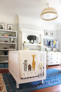 While I love to browse through the beautiful nurseries in catalogs, I wanted my nursery to have a more unique and eclectic look, so I shopped for a mix of new, store-bought items, like the crib, and distinctive decor, like the blue Moroccan Kilim rug my Laurel