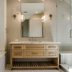 Natural wood cabinetry + classic marble countertop + stunning sconces = an inviting guest room bath at our 4218 Arcady project 🏡❤️… Laundry In Bathroom, Trendy Bathroom, Bathroom Shower Tile, Wood Bathroom Vanity, Bathroom Colors, Brown Bath Ideas, Bathrooms Remodel, Wood Bathroom, Bathroom Inspiration