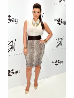 Kim Kardashian animal print skirt, bangle bracelets, and statement necklace by Belle Noel #style #celebstyle