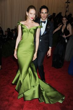 Uma Thurman arrived at the Met Ball on the arm of Zac Posen and wore an olive silk gown of his design.