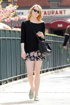 black off the shoulder tee, floral shorts, black carryall bag