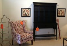 Classic wing chair with a stained black console and hutch.