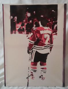 "Original stencil art of Brent Seabrook of the Chicago Blackhakws. The piece is 18""x24"" Spray paint on canvas. This picture is taken from the ice at the beginning of the game during the National Anthem. I took the original image edited it and produced layers, i cut those layers out, and sprayed them individually on the canvas.  This is a unique piece of art. It is done in the style and tradition of street art. It is meant to have flaws. This is NOT a print."
