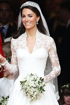 Ok, I'm going to admit to being a bit of a fan of Princess Kate's wedding dress. What I especially like is the corseted top bit under the lace though not the long sleeve or massive skirt/train