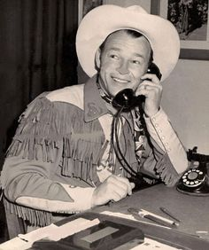 Roy Rogers conducts a little business on the phone.