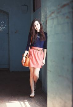Navy and coral. I'd add wedges and maybe a clutch instead of satchel but I love the color combo