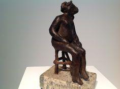 la silla en bronce