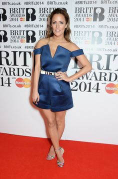 Pin for Later: Caroline Flack Has a Signature Look, and She's Not Ditching It Anytime Soon  Another night out, another teal look! Caroline wore this satin jumpsuit for the Brit Awards in 2014.
