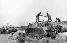 historywars:    A column of StuG III makes a stop along the way.