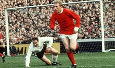 12th April 1968. Manchester United inside forward Denis Law leaves Fulham full back George Cohen stranded at Craven Cottage.