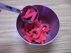 Alphabet Soup.  Children take turns scooping up a letter from a bowl w/a spoon or ladle.  Child identifies the letter & walks around room searching for the letter somewhere in the classroom