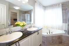 Owner's private ensuite / bath / bathroom in the Orion II showhome in King's Heights in Airdrie by Shane Homes Corner Bathtub, New Homes, House Design, Bathroom, Washroom, Corner Tub, Bathrooms, Architecture Illustrations, House Plans