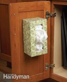 Use an empty tissue box to store plastic grocery bags- good idea!