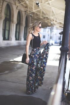 crop black top and funky pattern trousers