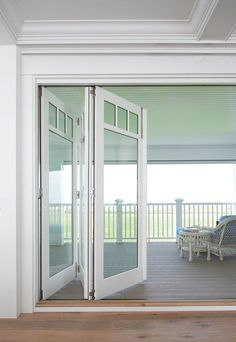 Windows, of course, open up the world outside. Invite the outdoors inside with sliding or folding glass doors. Indoor-outdoor living is seamless when you incorporate these into your home for access to porches, decks, pools and vistas. They can be rimless and contemporary or more traditional, as shown above, to complement the style of your home.