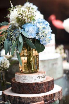 Rustic chic boy themed baby shower - cake table - naked cake - floral artistry - centerpiece - mason jar centerpiece - wood slice - eucalyptus - hydrangeas - blue