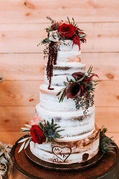 Semi-naked wedding cake idea - rustic, winter wedding cake with fresh flowers {Altar Ego Weddings}