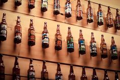 cool idea for a basement bar : using racks for watter bottles on bikes to hold beer bottles!