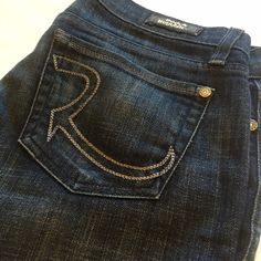 ROCK & REPUBLIC BOOT CUT JEANS Dark wash boot cut jeans size 26. Great low rise fit. Previously loved but still great jeans. Wear to hem is pictured. Rock & Republic Jeans Boot Cut