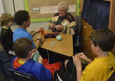 "Three boys sat in a school hallway, concentrating on the task literally at hand: knitting. ""Once you get it down, you can focus on it,"" said Owen Taylor, a fifth-grader"