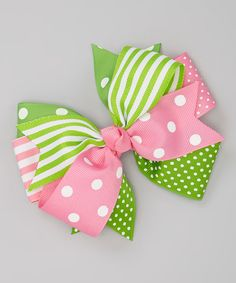 """Add sweet style to any lovely 'do with this playful polka dotted bow. Sporting a layered look and sturdy alligator clip base, it'll accent a little look with a touch of charm.5"""" W x 4.5"""" HPolyester / metalImported"""