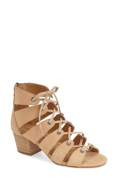 In love with these gorgeous caged sandals with eye-catching cutouts and laces for a trendy look.