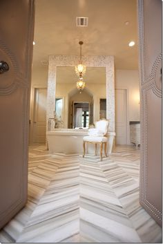 Chevron patterned marble floor.