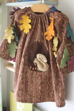 tree halloween costume with removable squirrel for scampering.  too cute.    http://probablyactually.wordpress.com/